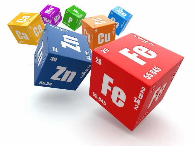 Elementos químicos em cubos com número atômico, massa atômica e configuração eletrônica, como na Tabela Periódica
